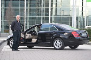 limo-driver-and-limousine